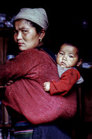 Mother and child in a papoose in Nepal