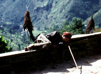 Sleeping Nepalese man on the trail