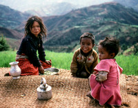 Three young children in the countryside in Nepal
