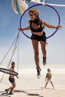 Woman on a swinging hoop at Burning Man in Black Rock City Nevada