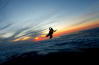 Tandem skydive with setting sun