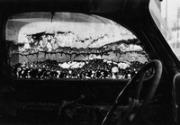 Monochrome image of a burned out car