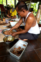 Mixing the meats for a Balinese dinner