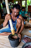 Pounding the meat with spice for a traditional Balinese dinner